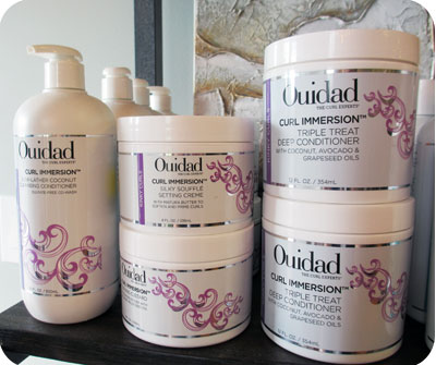 Ouidad hair care products on the shelves at Asalon
